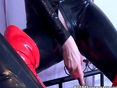 Kinky blonde whore in latex cloth blows