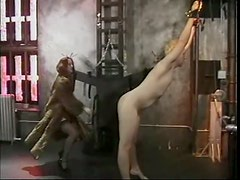 Redhead Dominatrix Teases with Pain