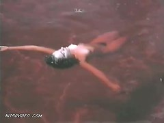 Delia Casanova Floating Naked in the Water