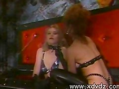 Tracey Adams Takes Out Pornsche Lynn From A Casket To Lick Her Latex High Heeled Boots