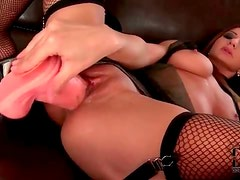 Lubed pussy fucked by a big dildo