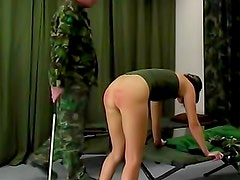 Military girl punished with a caning