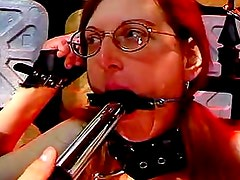 Nasty redheaded chick gets chained and brutally penetrated