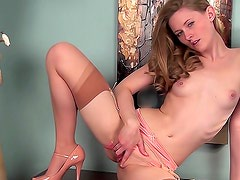 Sexy babe Vicky Marie is masturbating her kitty indoors