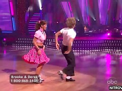 Mesmerizing Celebrity Brooke Burke Dancing In a Retro Fifties Outfit