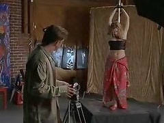 Busty Celeb Kristy Swanson Gets Tied To a Pole For a Photo Session