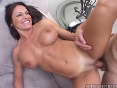 Sizzling brunette milf gets banged by her colleagues