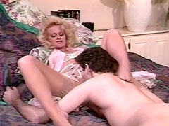 Lusty blondie talks on the phone and gets his cock hard