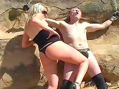 Abusive femdom blonde in the desert
