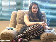 Sultry Latina milf showing off her legs whilst having a smoke