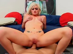 Trashy tattooed girl slowly sits on his cock