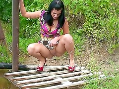 Cute busty girl takes a piss outdoors