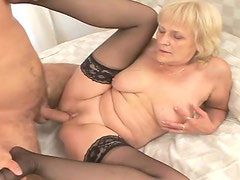 Blond mature lady gives him a nice blowjob
