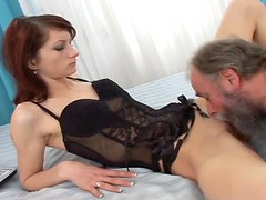 Sizzling redhead babe seduces this dirty old fart