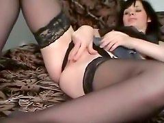 Hot stockings on chick masturbating to porn