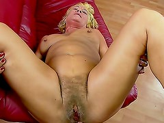 Short haired blonde Orhidea likes to ride on her lovely sex machine