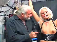 Cute blonde in pain in his dungeon