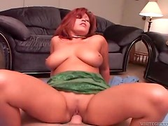 Curvy redhead hardcore sex on top of his cock