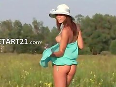 brunet young babe teasing outdoors