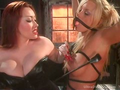Cruel Asian Dominatrix Punishes a Big Titted Submissive Blonde