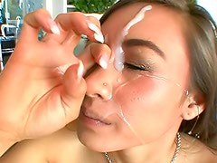 Facial cumshot splashes on cute chick