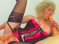 Mature blonde in sexy lingerie banging