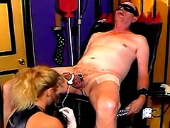 Mistress in boots abuses his dick and balls