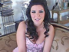 Glamorous solo brunette talks to the camera