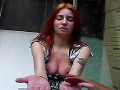 Redhead becomes a pain slut on camera