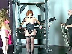 Bound corset girl flogged over her back