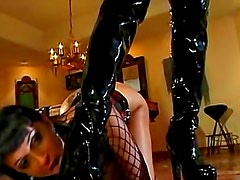 Latex lady Taylor Wane dominates a girl