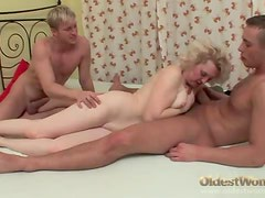 Old lady in lingerie stripped and fucked by two guys