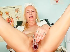 Mature nurse spreads her legs wide