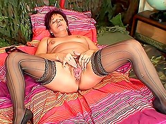 Curvy mature in lingerie arouses you