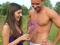 Young couple erotic fuck in a field