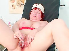 Fat old redhead nurse masturbates with toy