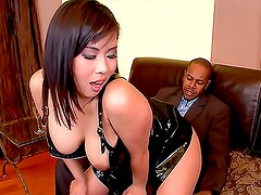 Asian in black latex boned in the asshole