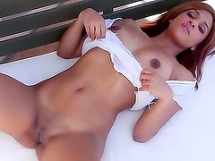 Slender babe with small tits strips