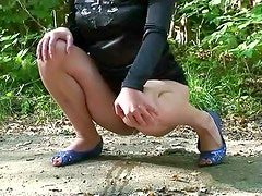 Blonde in tight dress pisses on ground