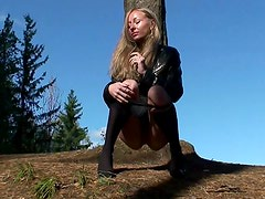 Leather jacket on pissing girl outdoors