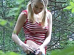 Voyeur view of teen pissing outdoors