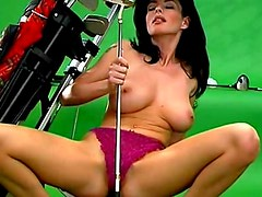 Golf babe fondles her big sexy tits