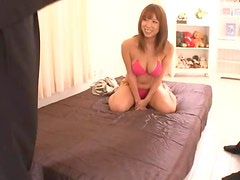 Asuka the sexy Japanese chick gives a blowjob and titjob to two guys