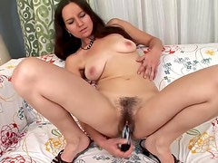 Hottie with a hairy hole fucks a toy