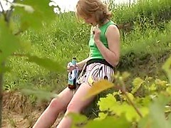 Short skirt lets teen piss in the dirt