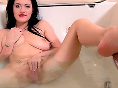 Brook Scott is taking off her lovely sexy black stockings