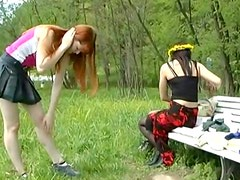 Redhead pissing on a magazine outdoors