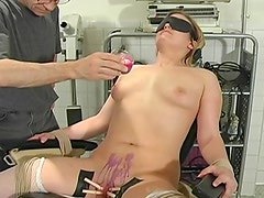 Hot wax dripped onto bound girl pussy