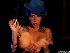Busty smoking girl toys her wet pussy with a dildo