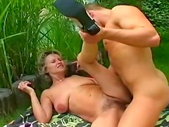 Making love to hairy mom in the grass